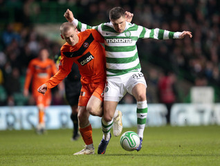 Celtic's Hooper controls the ball as Dundee United's Robertson challenges during their Scottish Premier League soccer match in Glasgow