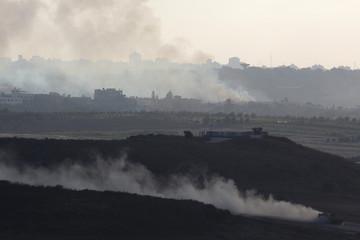 An Israeli APC drives near the border with the Gaza Strip