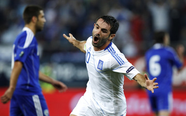 Greece's Karagounis celebrates a gaol against Israel during their Euro 2012 qulifying soccer match at Karaiskaki stadium in Athens