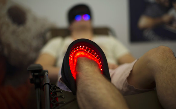 An attendee receives light therapy during the second annual Bulletproof Biohacking Conference in Pasadena