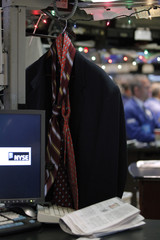 A jacket, two neckties and a newspaper are seen on the floor of the New York Stock Exchange in New York