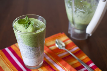 Healthy spinach and apple smoothie with milk and chia