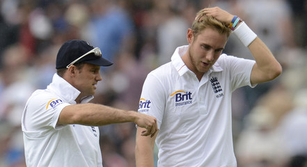 England's captain Strauss talks to Broad during the first cricket test match against South Africa at the Oval cricket ground in London