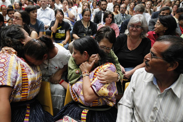 People react after former Guatemalan dictator Montt was sentenced for genocide charges in the Supreme Court of Guatemala City
