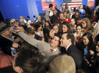 U.S. Republican presidential candidate Marco Rubio takes a selfie with a supporter following a campaign town hall at Easley High School in Easley
