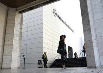 Attendees wait outside the location of the Mercedes-Benz Fashion Week Fall/Winter 2012 in New York's Lincoln Center