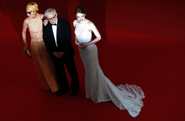 "Director Woody Allen, cast members Parker Posey and Emma Stone pose on the red carpet as they arrive for the screening of the film ""Irrational Man"" out of competition at the 68th Cannes Film Festival in Cannes"