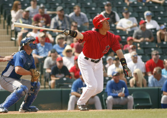 Angels' Matsui hits an RBI sac fly against Royals in third inning during MLB spring training game in Tempe