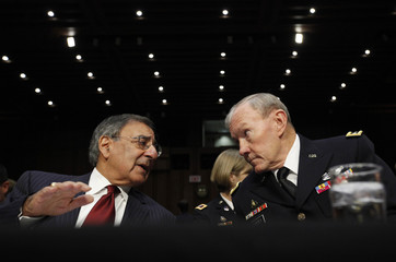 U.S. Secretary of Defense Panetta and Chairman of the Joint Chiefs of Staff Army Gen. Dempsey talk during a hearing on Capitol Hill in Washington