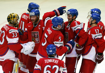 Czech Republic's players celebrate their win over Norway after their 2013 IIHF Ice Hockey World Championship preliminary round match at the Globe Arena in Stockholm