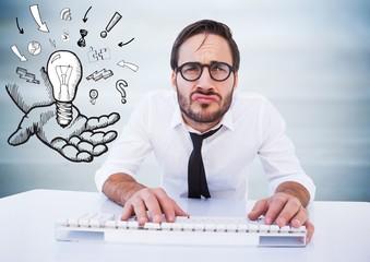 Business man at desk with lightbulb doodle