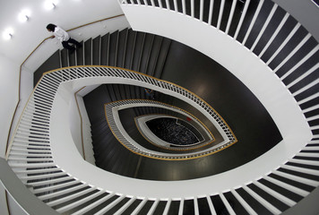 A man walks up a spiral staircase at the Museum of Contemporary Art in Chicago