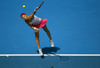 Safarova of the Czech Republic serves to Zvonareva of Russia during their match at the Australian Open tennis tournament in Melbourne