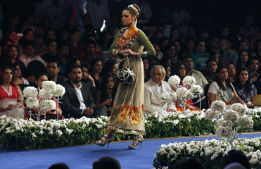 A model displays a creation by Pakistani designer Saira Rizwan during Bridal Couture Week in Lahore