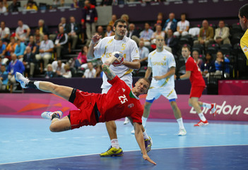 Hungary's Szabolcs Zubai takes a shot against Spain in their men's handball Preliminaries Group B match at the Copper Box venue during the London 2012 Olympic Games