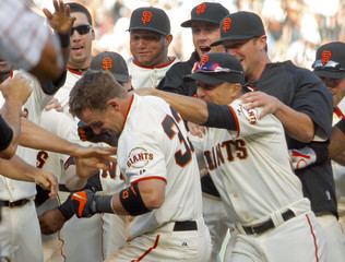 Giants' Rowand is mobbed by his teammates during 13th inning of their MLB National League baseball game in San Francisco