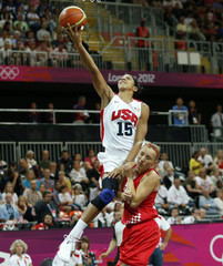 Parker of the U.S. goes to the basket past Croatia's Jelavic during their women's Group A basketball match at the London 2012 Olympic Games in the Basketball arena