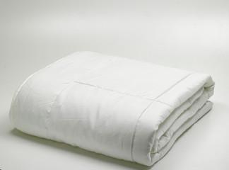 folded light white duvet/quilt isolated on white