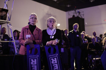Supporters of Conservative Party leader and Canadian Prime Minister Stephen Harper watch results come in for the Canadian federal election in Calgary