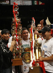 Montiel of Mexico celebrates after defeating Hasegawa of Japan during their WBC bantamweight title match in Toky