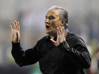 Tite, coach of Brazil's Corinthians, gestures during their Copa Libertadores match against Ecuador's Emelec in Guayaquil
