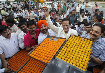 Supporters of BJP distribute sweets during celebrations after Modi was sworn in as India's prime minister in Chandigarh