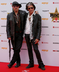Johnny Depp and Aerosmith's guitarist Joe Perry pose on the red carpet at the 2016 Classic Rock Roll of Honour awards in Tokyo