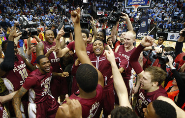 The Florida State Seminoles celebrate after beating the North Carolina Tar Heels during a college basketball game in Atlanta