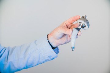closeup of a modern hip implant in the doctor's hands