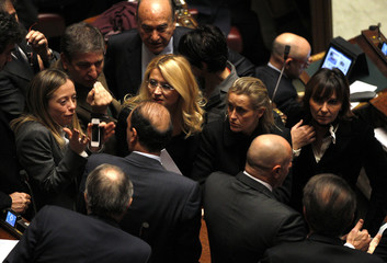 Alfano, secretary of Silvio Berlusconi's People of Freedom, talks with members of his party during a vote of confidence at the Lower House of Parliament in Rome