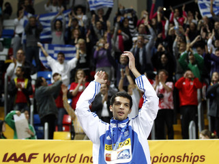 Chondrokoukis of Greece celebrates on the podium during the awards ceremony for the men's high jump at the world indoor athletics championships in Istanbul