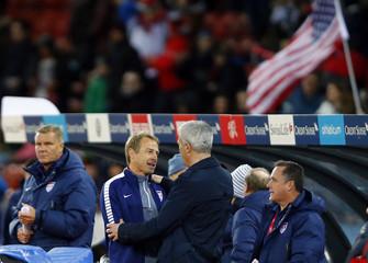 The U.S. team coach Klinsmann and Switzerland's team coach Petkovic hug after the international friendly soccer match between their teams at the Letzigrund Stadium in Zurich