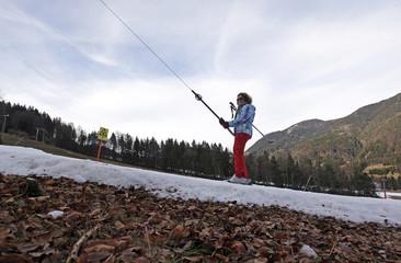 Skier rides a cable lift at Kranjska Gora Ski Resort, in Slovenia