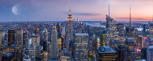 Manhattan midtown skyline panorama at night time, New York, USA