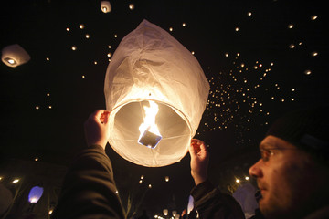 A participant holds up a sky lantern to be launched in Zagreb