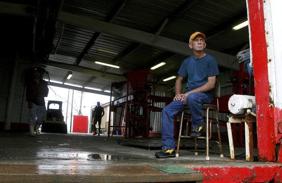 Twenty-Seven year shrimp farmer Robert Armand sits idle at Dean Blanchard Seafood in Grand Isle