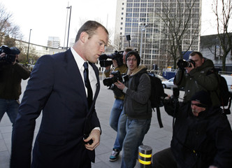 Manchester United striker Rooney arrives at the Manchester Civil Justice Centre, in Manchester, northern England