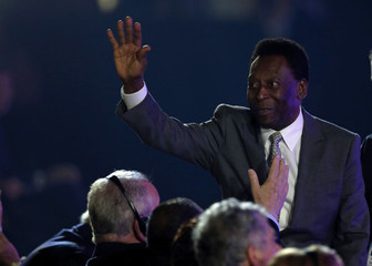 Pele waves his hand during the draw for the 2014 World Cup at the Costa do Sauipe resort in Sao Joao da Mata