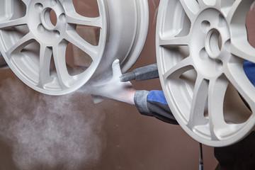 Process of powder coating wheels