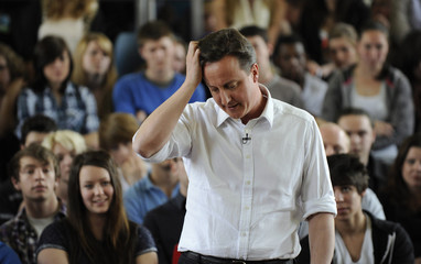 Britain's opposition Conservative Party leader, David Cameron, answers questions during a visit to a college in Brighton