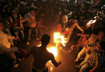 Egyptian soccer fans celebrate in the streets in Cairo