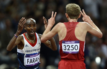 Britain's Mo Farah celebrates with second-placed Galen Rupp of the U.S.after winning the men's 10,000m final at the London 2012 Olympic Games