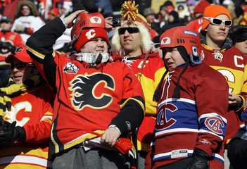 Hockey fans look on before the Calgary Flames play the Montreal Canadiens in the NHL Heritage Classic outdoor hockey game at McMahon Stadium in Calgary