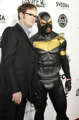 "Actor Rainn Wilson poses with Phoenix Jones, a masked man who calls himself a superhero, at the premiere of Wilson's new film ""Super"" in Hollywood"