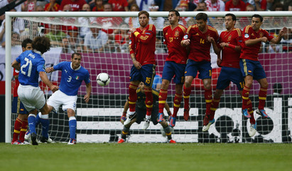 Italy's Pirlo takes free kick during Euro 2012 soccer match against Spain in Gdansk