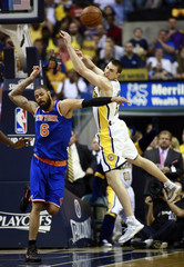 Indiana Pacers forward Hansbrough and New York Knicks center Chandler chase a rebound during the first half of an NBA Eastern Conference second round playoff basketball game in Indianapolis