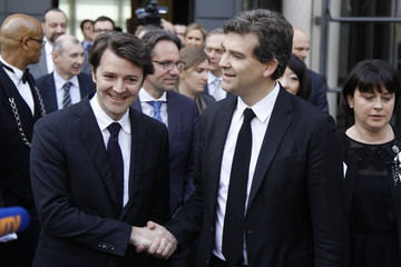 France's outgoing Minister of Economy, Finance and Industry Baroin and newly appointed Minister of Industrial Renewal Montebourg arrive for a handover ceremony in Paris