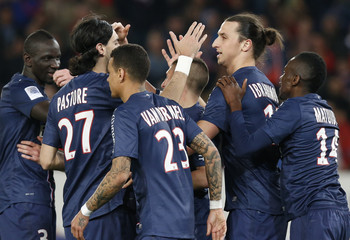 Paris Saint-Germain's Ibrahimovic is congratulated by team mates after he scored a penalty against Nice during their French Ligue 1 soccer match at the Parc des Princes Stadium in Paris