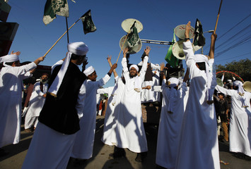Men dressed in Arabic clothing chant religious slogans as they take part in a procession to celebrate Eid-e-Milad-ul-Nabi, the birth anniversary of Prophet Mohammad, in Karachi