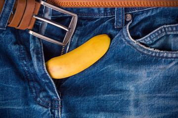 Banana out of mens pants like mens penis. Potency concept